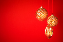 Three Golden Christmas Baubles...