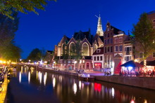 Old Church (Oude Kerk) And Amsterdam Canals At Night, Netherlands