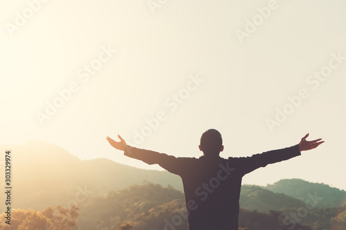 Copy space of silhouette man rising hands up on sunset sky and clouds abstract background Fototapeta