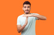 Leinwandbild Motiv I need more time! Portrait of frustrated brunette man with beard in casual white t-shirt showing time out gesture, looking with imploring eyes, hurry to meet deadline. studio shot on orange background