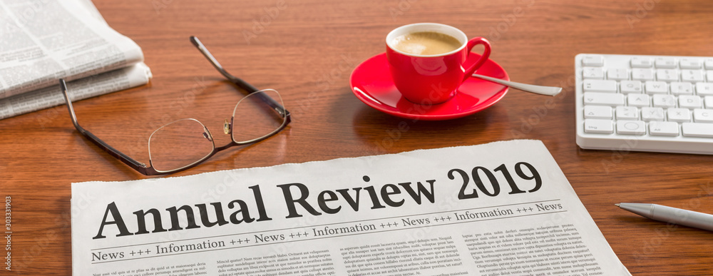 Fototapeta A newspaper on a wooden desk - Annual review 2019