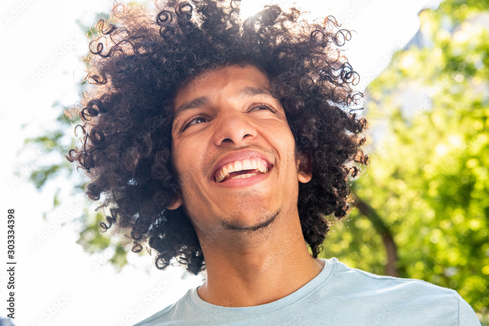 Fototapety, obrazy: Close up handsome young North African man with afro hair smiling outside