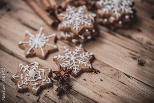 Fototapeta christmas cookies on christmas decoration rustical background obraz