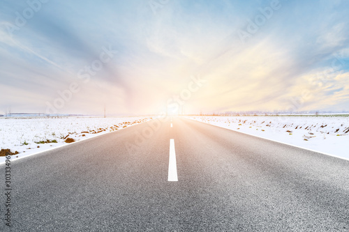 Obraz Country road and farmland snow scene at sunset - fototapety do salonu