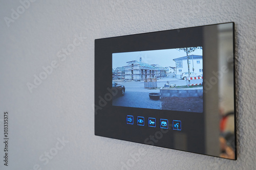 Obraz na plátně Intercom with video image mounted on the wall in the house