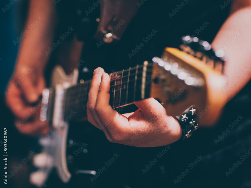 Fototapety, obrazy: Live rock concert. Male punk musician with electric guitar.