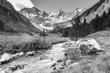 canvas print picture - Wildbach vom Gletscher im Zillertal in schwarz weiß