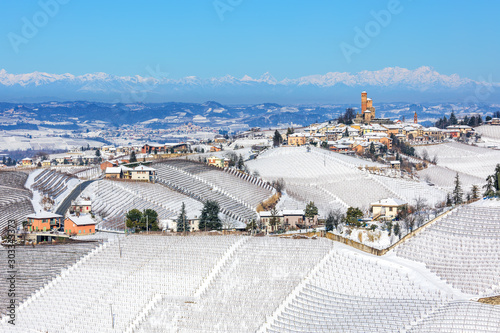 Foto auf AluDibond Blau Rural houses ans small town on the hills covered in snow.