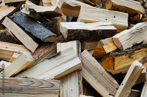 Photographie  pile of wooden logs, preparing for winter