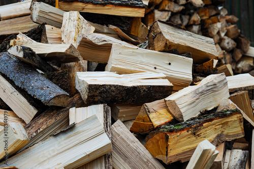 Fotobehang Brandhout textuur pile of wood logs