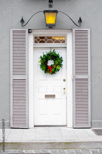 Clean white front door with Christmas wreath during Christmas holiday season Canvas Print