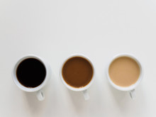 Three Cups Of Different Coffee On A White Background
