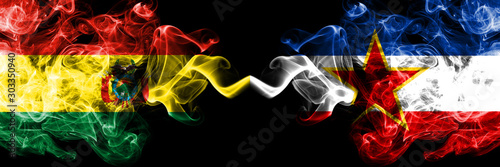 Bolivia, Bolivian vs Yugoslavia smoky mystic states flags placed side by side Canvas Print