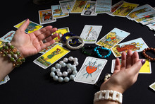 Bangkok,Thailand,november.17.19. Gypsy Lays Out Tarot Cards And Wonders For The Future. Christmas Fortune Telling And Fortune Telling. Magical Sessions With The Cards. Women's Hands And Tarot Cards.