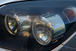 old and dirty car headlight