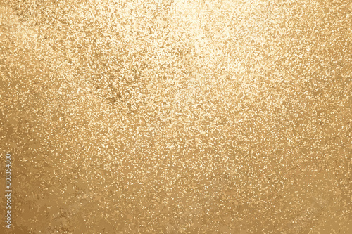 Foto  Gold color of glitter textured background (Vector)