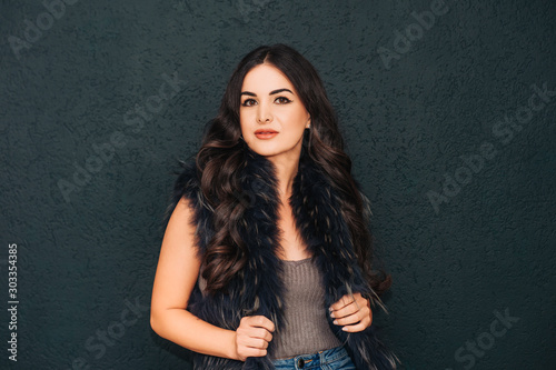 Beauty portrait of pretty young woman with bright makeup and long black hair Canvas Print