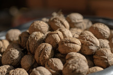 A Pile Of Walnuts. Full Bucket Of Ripe Walnuts
