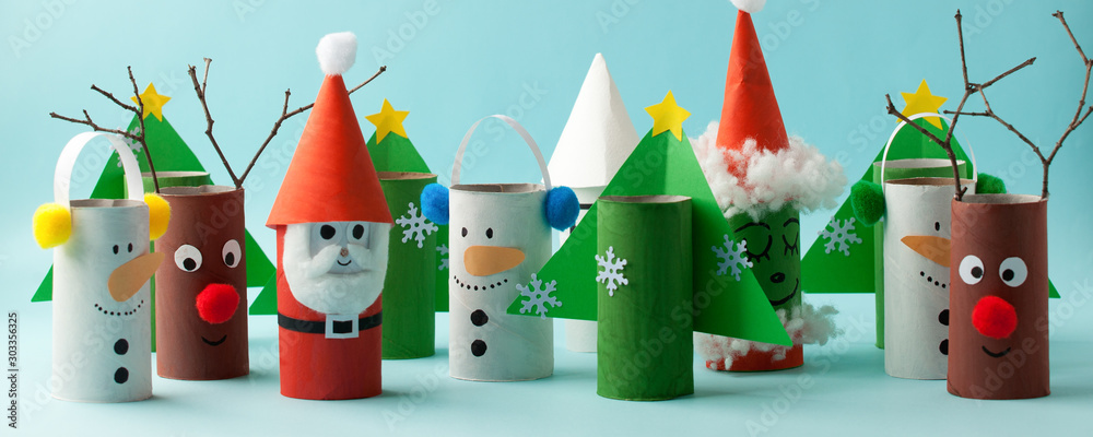 Fototapeta Santa claus, Grinch, Snowman from toilet tube roll for winter holiday decor. A terrible craft. School and kindergarten. Handcraft creative idea for Christmas new year, banner