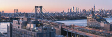 Williamsburg Bridge And Midtown Manhattan Skyline.