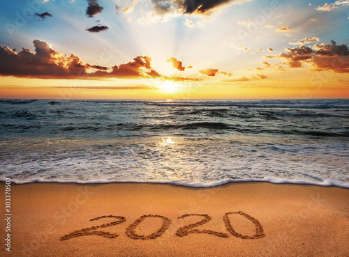 Obraz Happy New Year 2020! Written 2020 on the beach. - fototapety do salonu