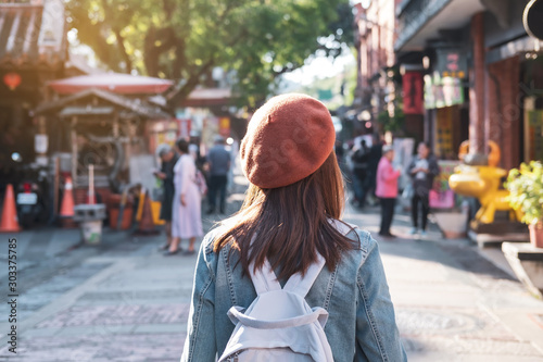 Obraz Young woman traveler walking in the shopping street, Travel lifestyle concept - fototapety do salonu