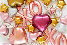 XOXO Foil Balloon Letters And Air Balloons Of Heart Shaped And Stars. Love Concept. Holiday And Celebration. Valentine's Day Or Wedding/bachelorette Party Decoration. Colorful Metallic  Air Balloons.