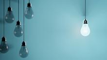 Hanging Light Bulbs On Blue Ba...