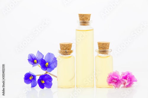 violet essential oil in  beautiful bottle on White background