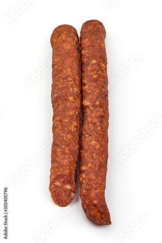 Leinwand Poster Spicy dried sausage, isolated on white background