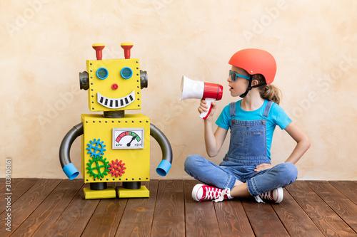 Fototapeta  Happy child with toy robot