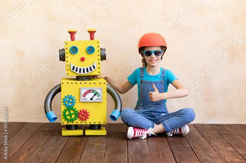 Obraz na plátně  Happy child with toy robot