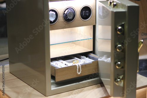 Fototapeta Security metal safe with pearl necklace, diamond jewelry and expensive watches inside obraz