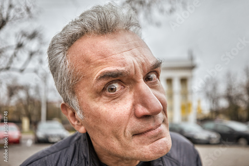 Obsessive passerby with a questioning look. Fototapet
