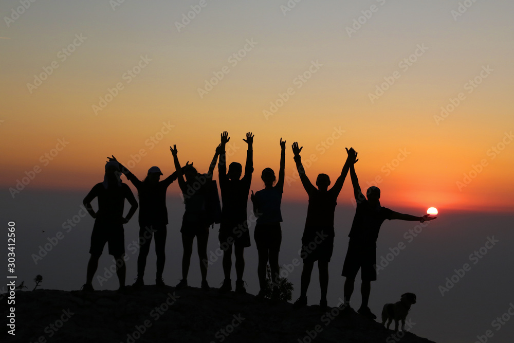Fototapety, obrazy: Silhouettes of tourists traveling along the Lycian trail during sunset.