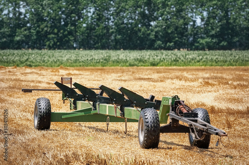 Agricultural machinery on the field Fototapeta