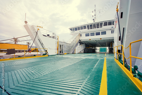 Stampa su Tela Ferryboat loading or unloading by a port pier