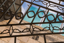 Fragment Of Forged Decorative Iron Fence. Decorative Forged Steel Grating. Vintage Forging In The Austrian Hospice In Jerusalem, Israel. Detail