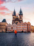 Beautiful view of Old Town colorful buildings and Tyn church at sunrise in Prague