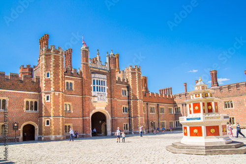 Foto auf Leinwand Altes Gebaude London, UK. English architecture Tudors time, West Front of Hampton court with entrance gate, locates in West London
