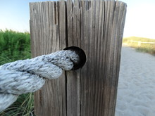 Closeup Of Rope And Fence Post...