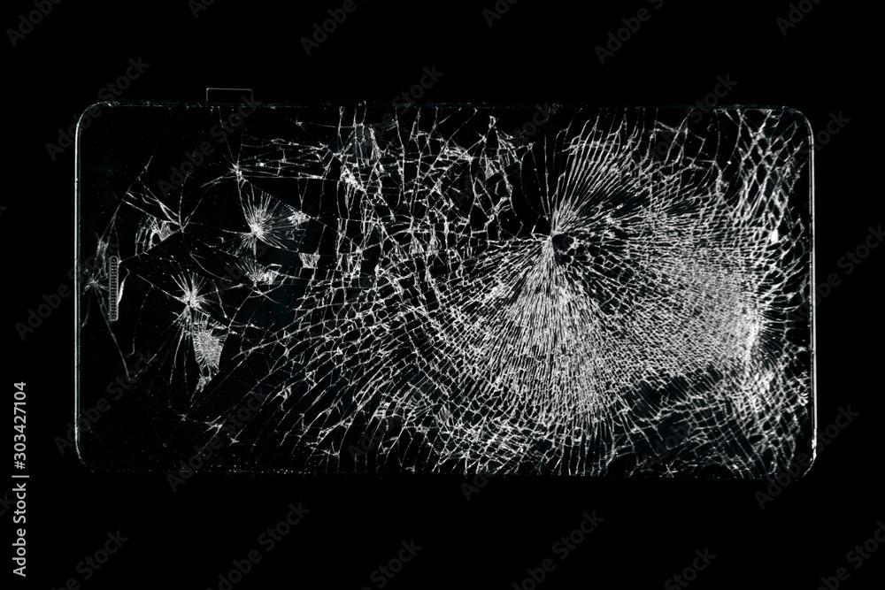 Fototapeta Broken phone screen, large cracked glass on a black background