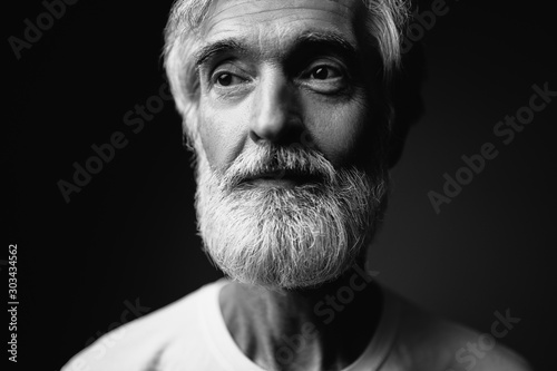 Obraz Close up studio portrait of handsome senior man with gray beard. - fototapety do salonu