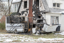 Burned Out Recreational Vehicle  Parked Next To Home Has Burned The House Down Too