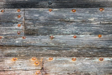 Wooden Boatside With Rusted Screws, Rotten And Stranded Boat Wreck On Land. Texture And Rustic Pattern Concept With Copy Space For Text.