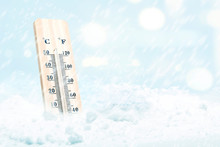 Wooden Thermometer With The Low Temperature At Winter