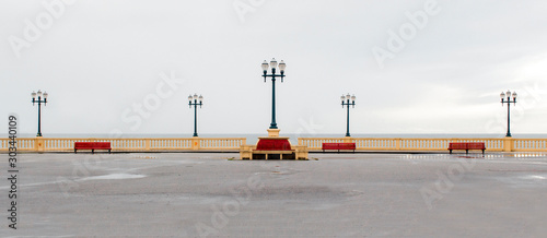 Photo Promenade over Atlantic Ocean / Sea with street lamps and benches in Porto
