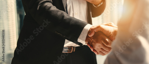 Photo business background of businessman having handshake