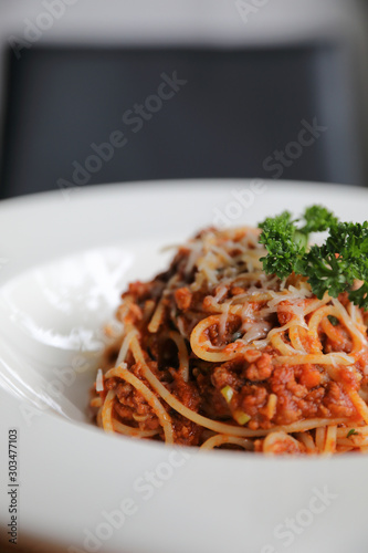 spaghetti Bolognese with minced beef and tomato sauce garnished with parmesan ch Canvas Print