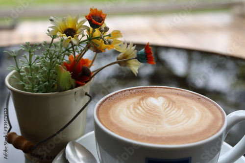 Foto auf AluDibond Kaffee hot latte coffee drink put on table in cafe